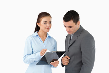 Businesswoman explaining data to her partner
