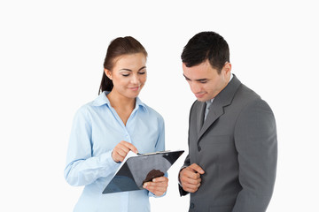 Businesswoman showing data to her partner