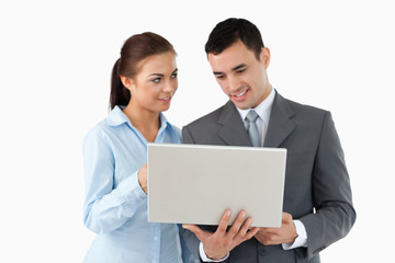Business partners using laptop