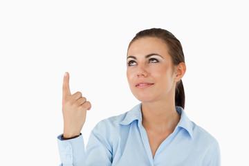 Businesswoman pointing with her finger upwards