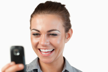 Close up of businesswoman being happy about text message