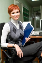 Young girl at work in the office