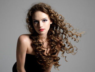 Glamour woman with curly hair