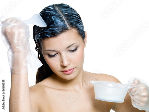 Woman dyeing brown hairs