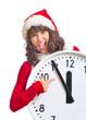 aggressive Frau mit großer Uhr zu Weihnachten