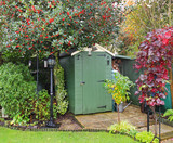 English back garden with Shed and lamp