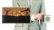 Businessman dragging videos about renewable energies