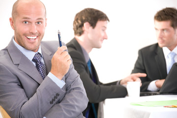Happy businessman at a meeting