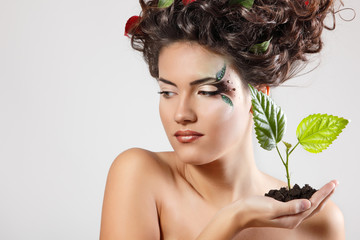 teen girl beautiful ecology with green tree shoot
