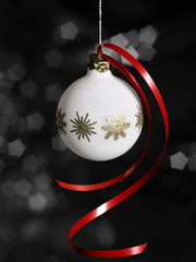 white Christmas bauble in dark back