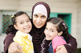 Muslim arabic mother with two daughters, love and care