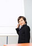 Genius boy making a  presentation poster