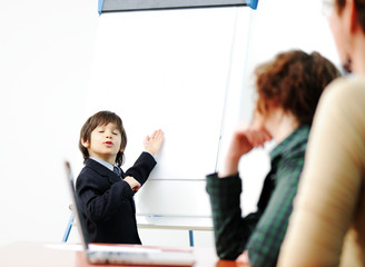Little kid making presentation to adults, business meeting