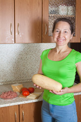 Woman with vegetable marrow