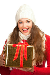 Beautiful woman holding christmas present