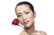 Close-up of a young Asian woman holding a Rose