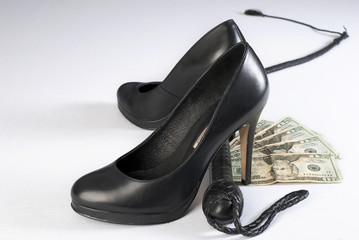 Black Leather Bullwhip, high hells shoes and money.