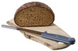 brown bread on shelf with knife