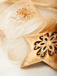 Rustic christmas star and gift ribon closeup