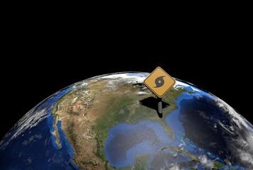 hurricane warning sign on North America globe illustration