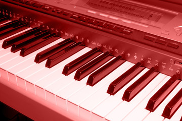 colored red photo of electronic piano