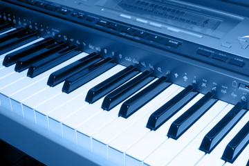 colored blue photo of electronic piano
