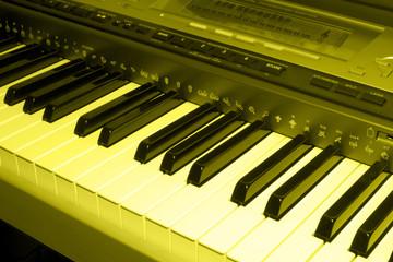 colored sepia photo of electronic piano