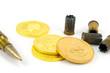 Patrone und Goldmünze