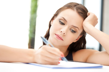 calm woman with big notepad