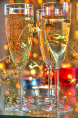 Close-up of champagne in glasses and candle lights.