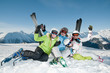 Ski, snow, sun and fun - happy family on ski holiday