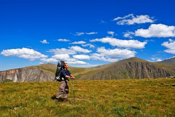 hiker in a altai mountain plateau