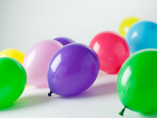 colorful ballons over a white background