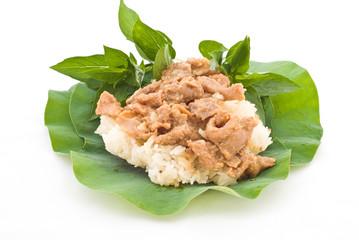 Thai foods, stirred pork with stickyrice on lotus leaf