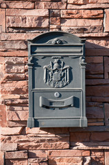 Beautiful mailbox on a brick wall, a summer day