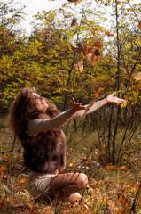 woman  sitting on a leaf