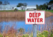 Sign warning of deep water.