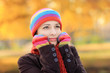 Beautiful young female with woolen cap and gloves in autumn