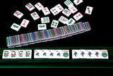 A winning Mahjong hand on black background.