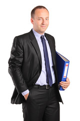 Portrait of a happy businessman holding a folder with documents