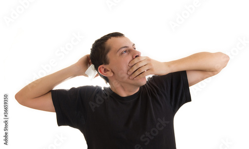 Man yawning and stretching