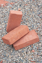 Three red clay bricks