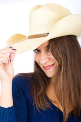 Friendly country girl tipping her cowboy hat
