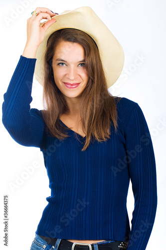 Pretty country girl with a cowboy hat on