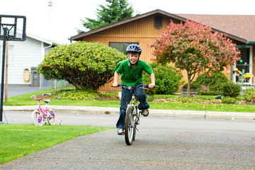 active young boy riding a bike