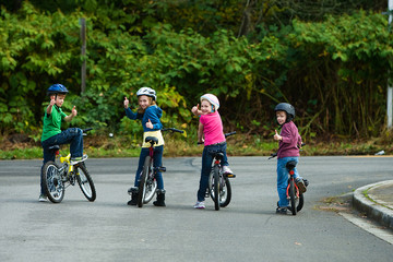 Group of kids looking back on their bikes