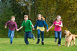 Group of kids running in a field