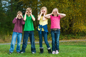 Kids playing with fake binoculars