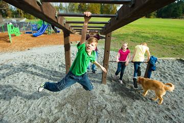 Boy playing on a school playground