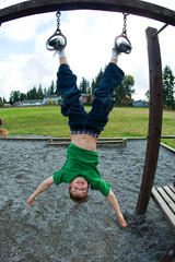 Young boy hanging upside down